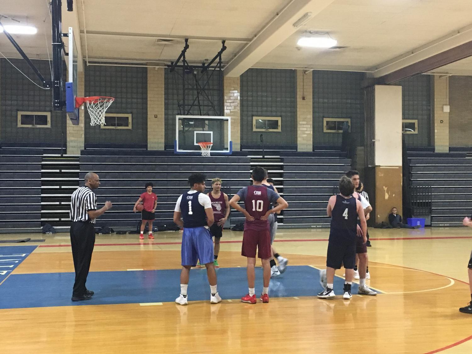 A player takes free throws for his team during a recreational basketball game. Teams usually play on various weeknights throughout the winter season.