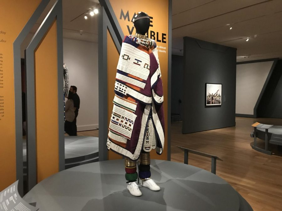The South African Fashion exhibit utilizes clothing and unique materials to represent the cultural identities of the artists.