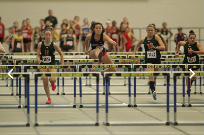 Jump! Sophomore Jamie Chamberlain (middle) competes in an indoor hurdles event at the Reggie Lewis Track and Athletics Center in Boston. She currently holds the school record for the 55 meter hurdles and the long jump.