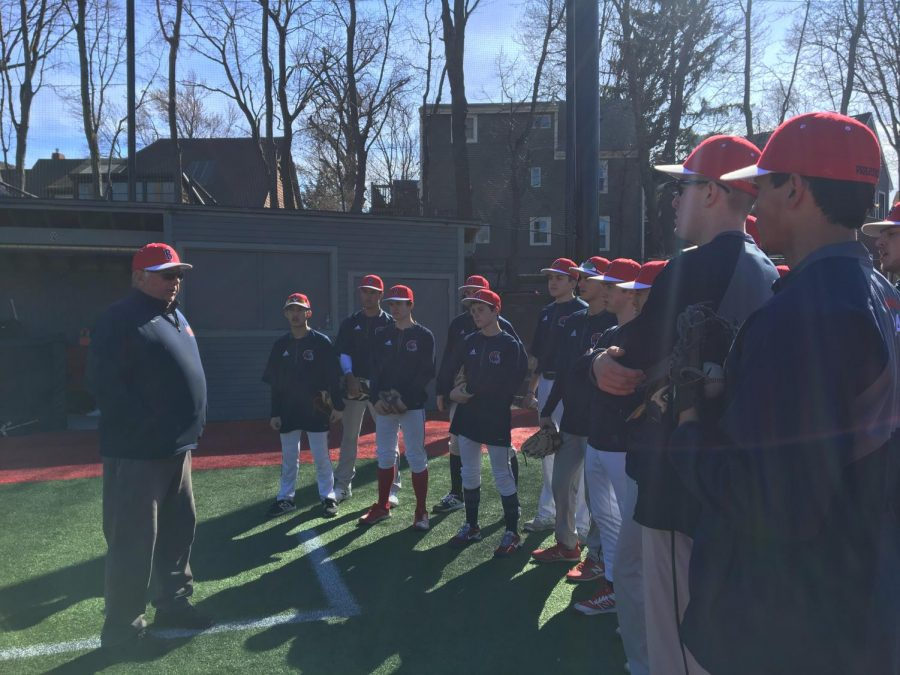Varsity+baseball+coach+Joe+Campagna+meets+with+his+team+before+practice+at+Parsons+Field.+Campagna+is+now+retiring+after+having+won+over+300+games+in+his+27+years+of+coaching.
