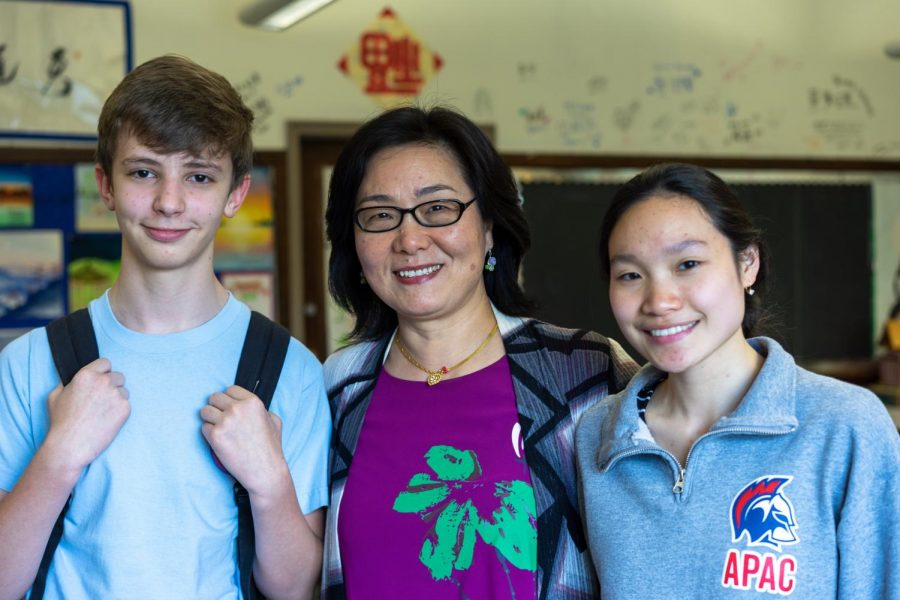 "Chinese teacher Lihua Shorter with two of her students. Those that know her call her ""loyal"" and ""someone who cares deeply about peace and justice in the world."""