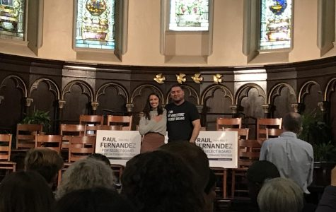 Select Board candidate Raul Fernandez and Congresswoman Alexandria Ocasio-Cortez speak at a rally at the First Parish Church in Brookline on May 5, 2019.