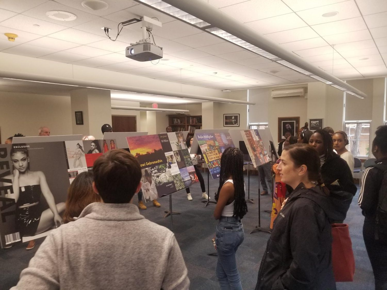 Visitors in the MLK room during X-block Thursday Oct. 10, view the final portfolios of students in the LiveInspired program.