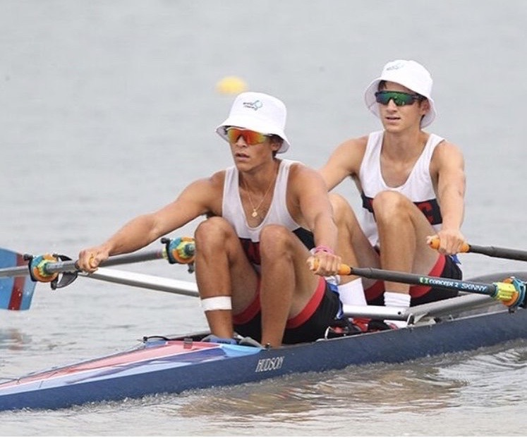 Senior Arik Stolyarov (left) and junior Justin Grossman (right) race a double at the Royal Canadian Henley with the  Brookline summer program.