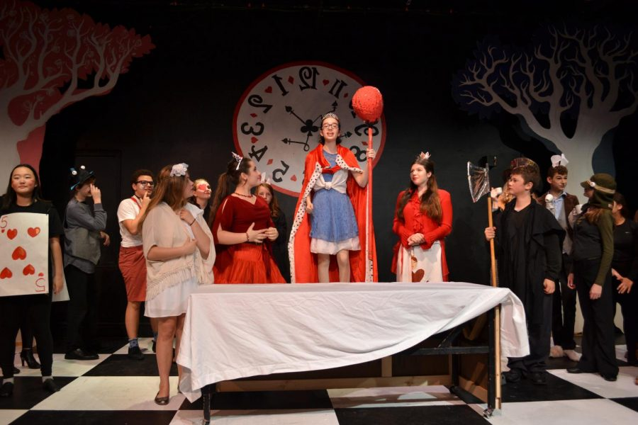 The set helped to immerse the audience into the strange and peculiar Looking-Glass Land. Pictured here from left to right is the White Queen (Eden Tradesman), the Red Queen (Valentia Burlak), Alice (Maya Shavit) and the Queen of Hearts (Mila Stojanov).