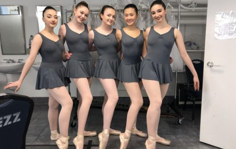 Juniors Sophie Roy (middle), Alyssa Chen (right) and senior Gigi Walsh (far right) pose in their pointe shoes after their 2018 Spring Showcase. The dancers practice six days a week.