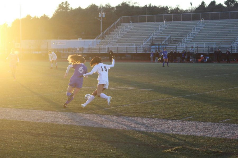 Sophomore Zoey Fagnan sneaks by an Andover defender. The Warriors successfully maintained dominance over their opponent to earn a victory.