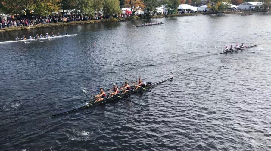 Juniors Justin Grossman and Hugo Harington and seniors Arik Stolyarov and Nicholas Slayton compete in a four-person boat at the Head of the Charles