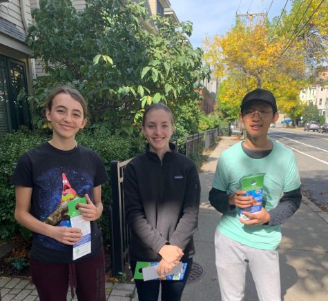 Members of the Environmental Action Club encourage Brookline residents to OPT UP to 100 percent renewable energy. This program allows people to reduce up to 6,000 pounds of carbon annually.
