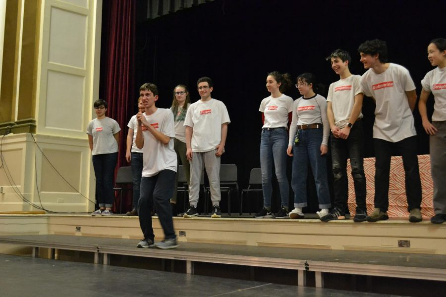 Senior Noam Scully delivers a monologue in the improv game