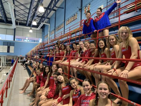Members of the girls swim and dive team prepare for one of their many swim meets in the Evelyn Kirrane Aquatic Center.