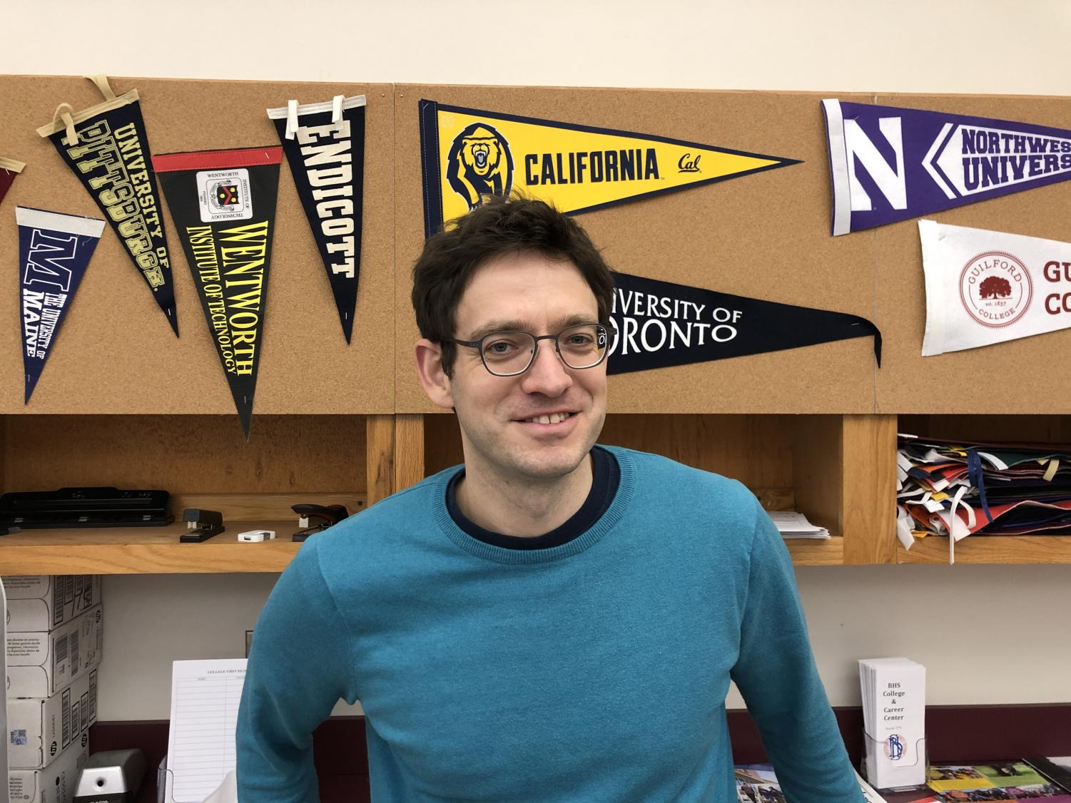 Lenny Libenzon, an alum of the high school and now a college and guidance counselor, works to help students through the college process.