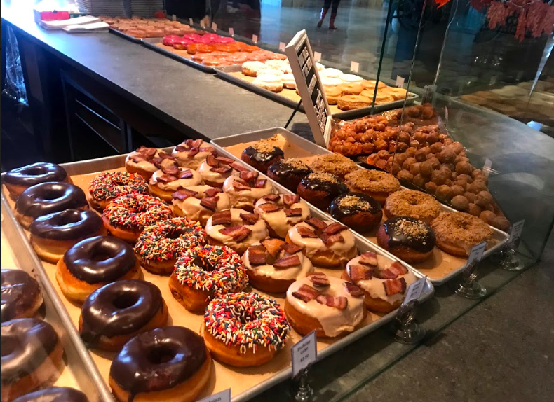 With flavors ranging from Pumpkin Cheesecake to Holiday Brownie Crumble, shops around the Brookline and Boston area offer customers a wide variety of unique speciality doughnuts.