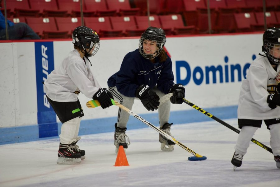 According to senior Josie Luby, the children and the volunteers learn from each other. While the kids learn about the basics of hockey, volunteers learn how to look at the game differently.