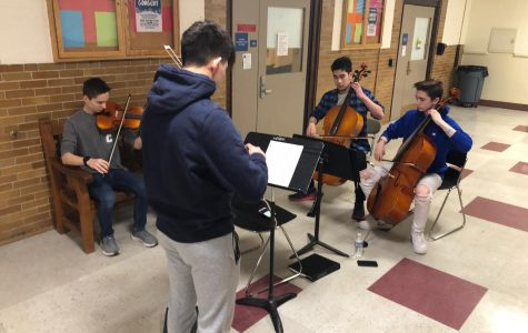 From left to right: sophomore Elliot Pertell, and freshmen Winston Stoll, Joseph Pearlman, and Michael Soares. Chamber groups are able to select the repertoire they wish to perform.
