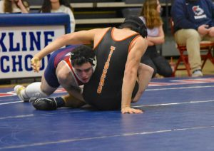Boys varsity wrestling team pins down back-to-back bay state championship