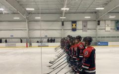 Boys varsity hockey team takes their places as they wait for the game to begin.