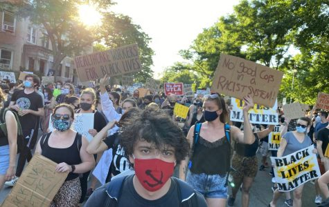 Protestors march down Harvard Street on June 19, 2020 in a demonstration against police brutality and racism. Over 4,500 people attended the event.