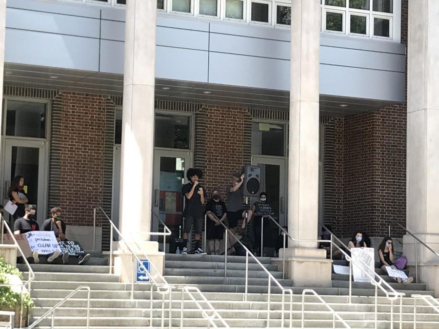 BHS students and staff gave speeches during the June 8 protest to support the Black Lives Matter movement. One of the speakers, Junior Kazi Stafford, stands in front of the high school to deliver his speech.