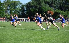 Many seniors are having a hard time being recruited during the pandemic, but athletes have adapted to changes and found success in recruitment. Above, Senior Aine Downey plays lacrosse. She is committed to Connecticut College's Class of 2025.