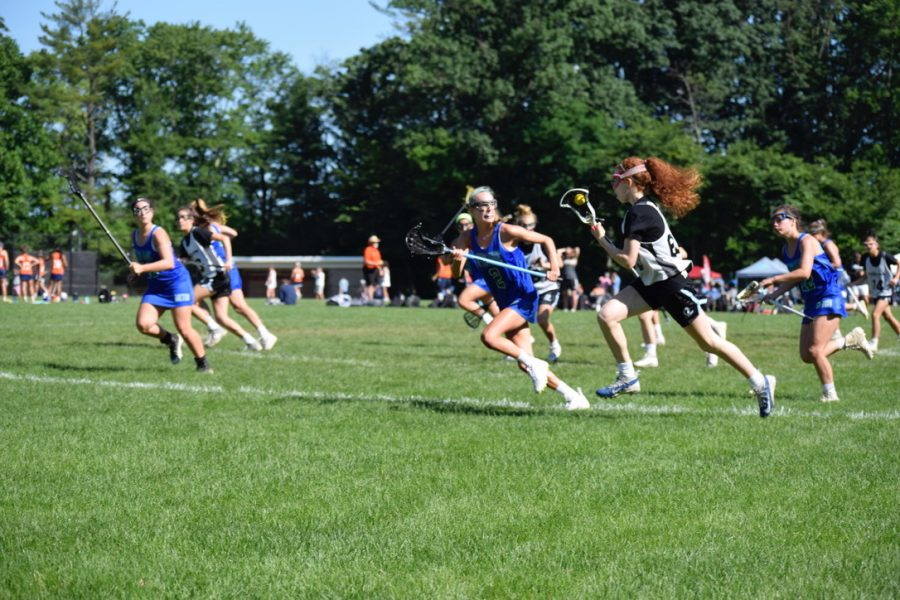 Many+seniors+are+having+a+hard+time+being+recruited+during+the+pandemic%2C+but+athletes+have+adapted+to+changes+and+found+success+in+recruitment.+Above%2C+Senior+Aine+Downey+plays+lacrosse.+She+is+committed+to+Connecticut+College%E2%80%99s+Class+of+2025.+