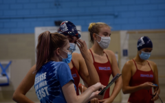 Along with changes to swim practices like mask requirements out of the water, the team has had to change its traditional team-building activities.
