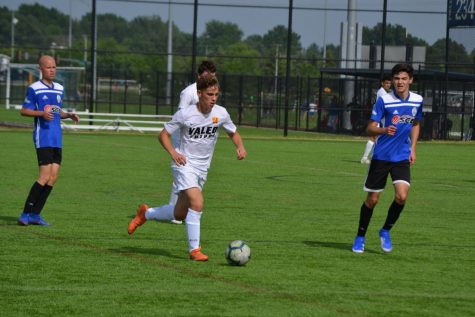 Senior and captain of boys varsity soccer, Rex Feldgoise (in white), sees strengths in each player that unite the team.