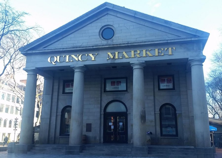Quincy Market's once-crowded steps have emptied, with the crowds of tourists that normally characterize this landmark gone.