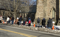 Area residents waiting in line at the St. Paul Street Church location of the Brookline Food Pantry. Since the start of the COVID-19 pandemic, the food pantry has seen more visitors as the problem of food insecurity grows. According to Barbara Trevisan of Pine Street Inn, food insecurity and homelessness are often linked to one another.