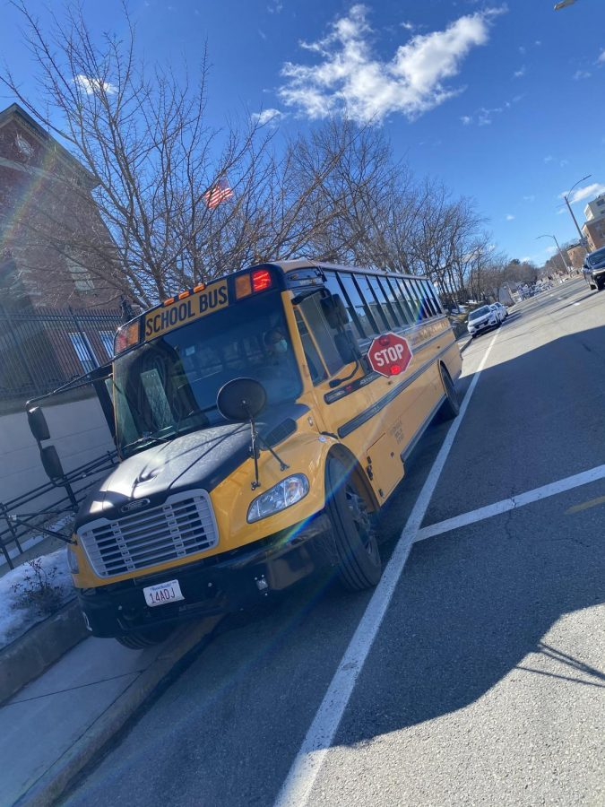 School bus parked outside of Old Lincoln School