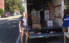 Volunteers help load and unload Food Pantry trucks. The Food Pantry allows Brookline residents to continue helping their community during the pandemic.