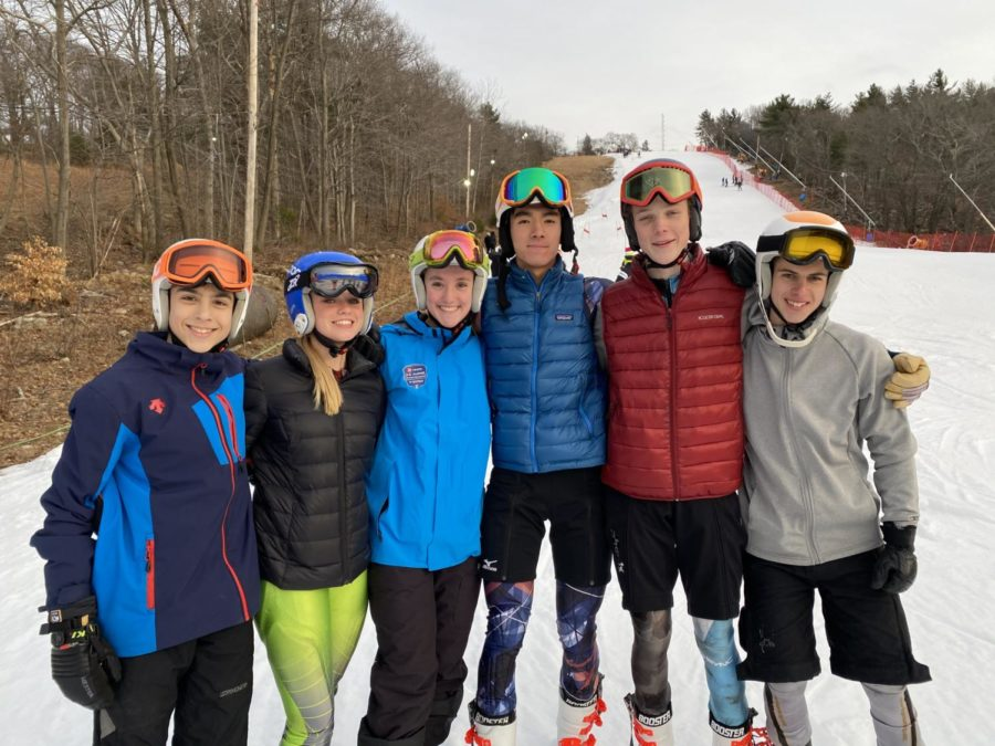 The ski team poses for a photo during their 2019/2020 season. Because of COVID-19 complications, the ski team missed out on many integral parts of their season.