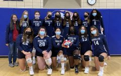 Girls volleyball team poses for group photo